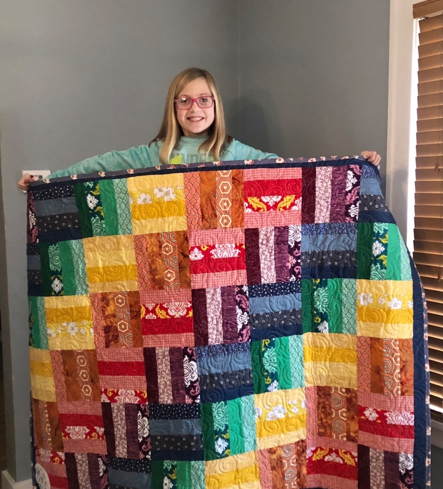 Fourth Grade Student Claire Stephens Creates & Donates Quilt.