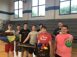 Jersey High School Football team helps the Red Cross set up a  shelter at East Elementary.