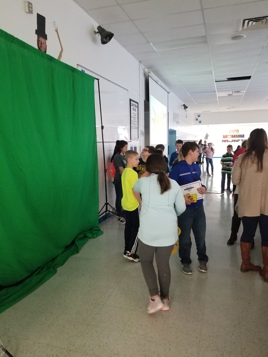Students took pictures of character award winners using a green screen.