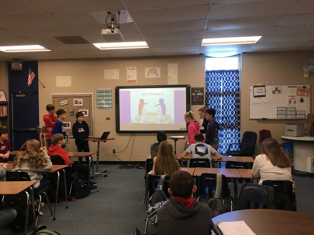 7th grade students competing in debates.